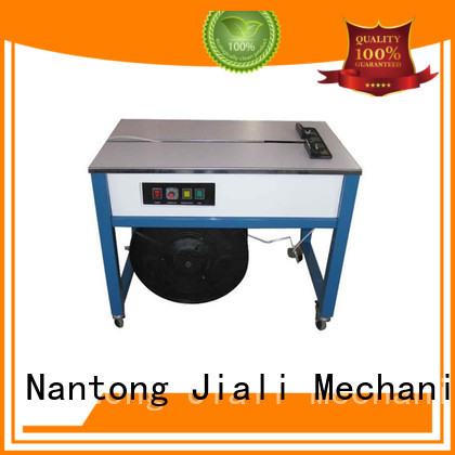Jiali enclosed semi automatic strapping machine for sale for newspaper packing